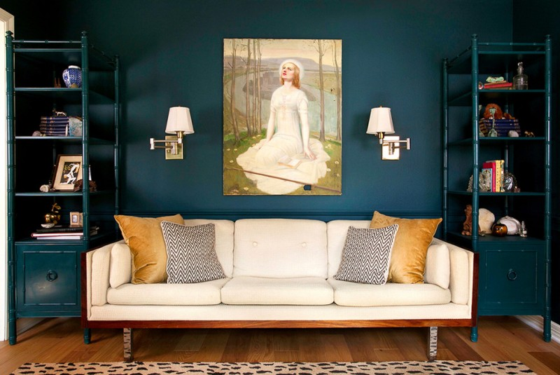teal room teall cabinet with shelves art wall decor beige sofa area rug wall sconces black and white pillows golden pillows
