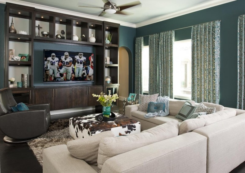 teal room window built in cabinet recessed lighting ceiling fan beige sofa swifel leathered chair blue curtains coctail ottoman shag rug