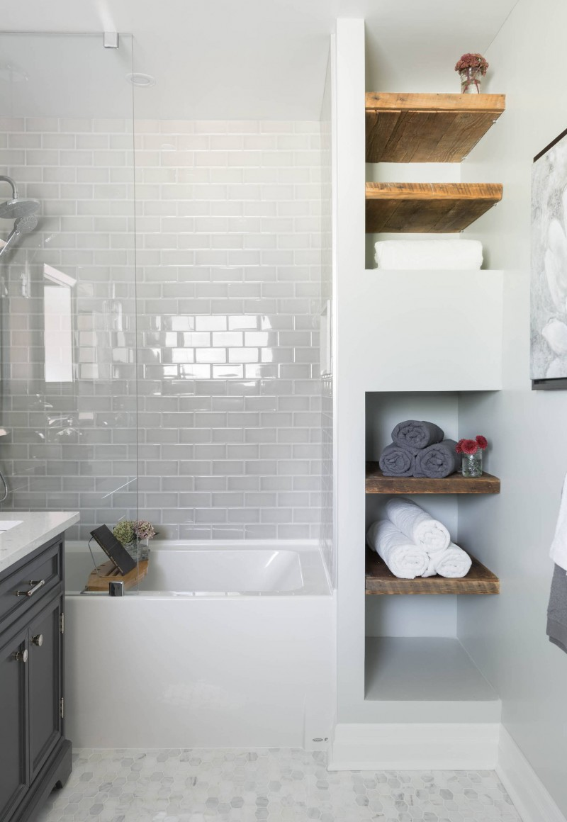tiled wall marble floor low height tub gray cabinet undermount sink floating shelves wooden shelves