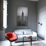 Triangular Table Eggplant Chair Empire State Building Art Gray Sofa Gray Walls Floor Tiles Small Floor Lamp Swivel Chair Window