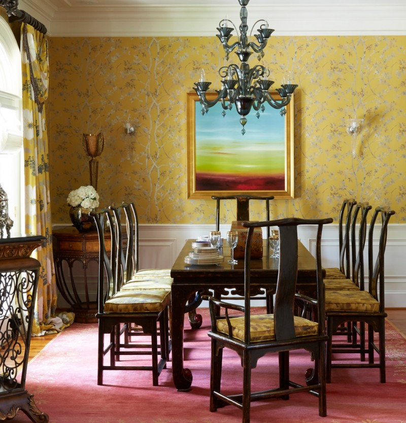 yellow dining room yellow wallpaper black classic chandelier window yellow curtains wood dining table and chairs with yellow cushions red rug