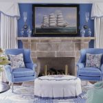 Antique Wingback Chair Blue Walls Blue Wingback Chair Ottoman Artwork Area Rug Fireplace Green Chair White Curtains And Valances