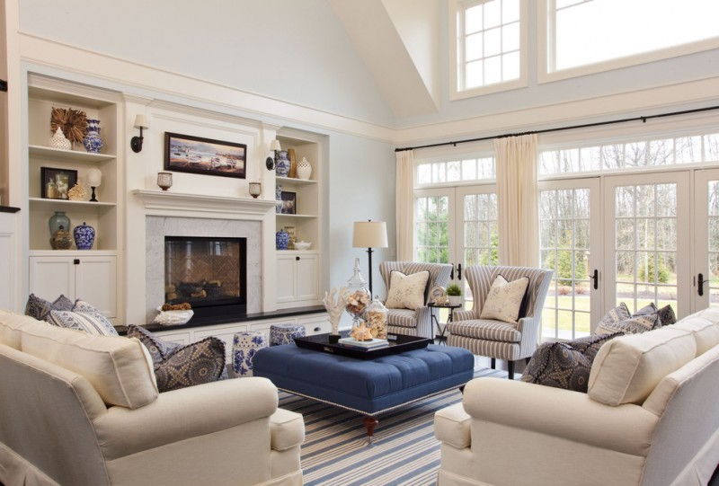 antique wingback chair stripe treatment chairs windows french doors curtains blue ottoman big tray white sofa area rug fireplace