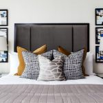 Art Deco Bedroom Furniture Abstract Wall Decor Headboard Colorful And Patterned Pillows White Wall White Table Lamps