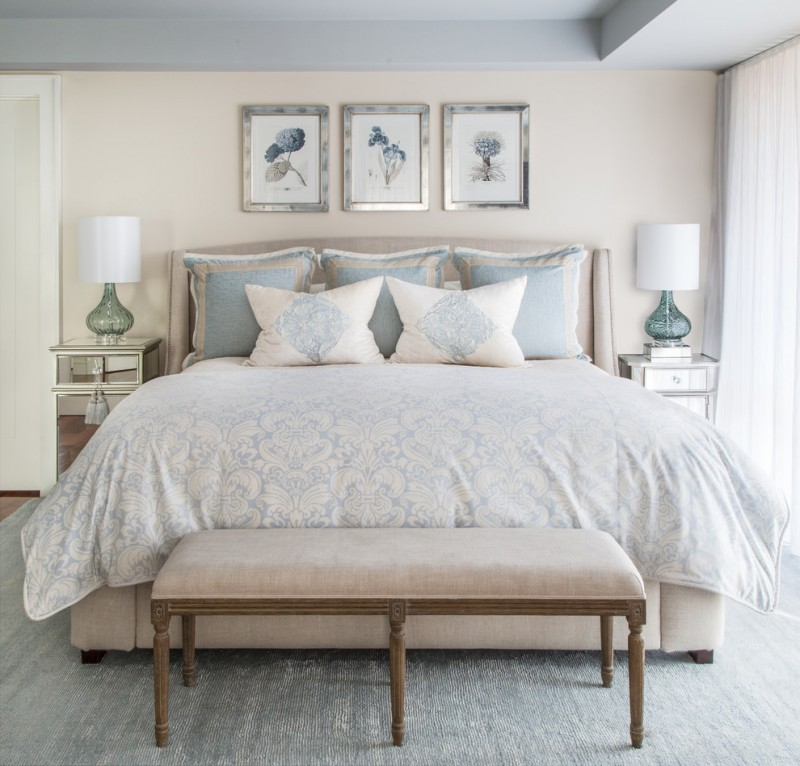 art deco bedroom furniture blue artworks with silver frames soft blue bedding small mirrored nightstands bench white curtains
