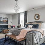 Art Deco Bedroom Furniture Chandeliers Artwork Mirror Grey Bed Colorful Bedding Silk Grey Curtains Mirrored Nightstands Blue Rug Sofa