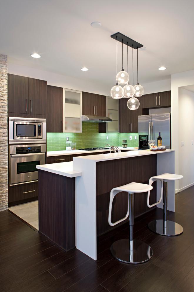 backsplash for dark cabinets green backsplash expresso kitchen cabinets kitchen island white countertops pendants barstools