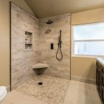 Beige Wall Stone Floor Built In Toilet Corner Seat Shower Tiled Wall Drop In Sink Dark Wood Cabinet