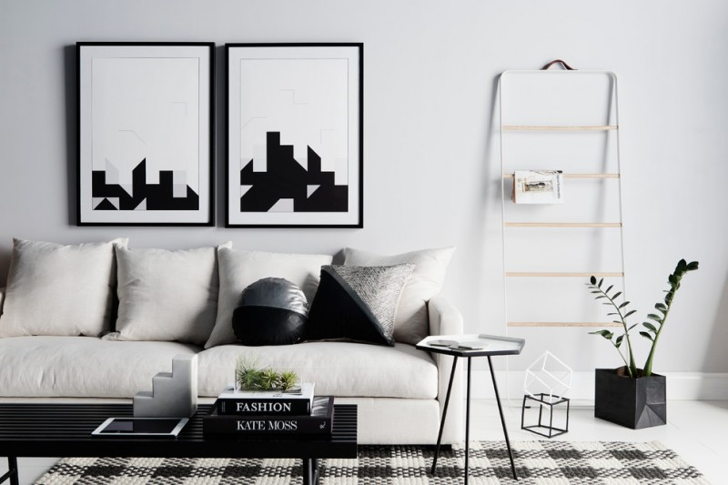 black and white living room furniture area rug black coffee table white sofa black and white decor side table indoor plant