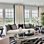 Black And White Living Room Furniture Black And White Rug White Sofa And Armchair Black Armchairs White Curtains Table Lamp