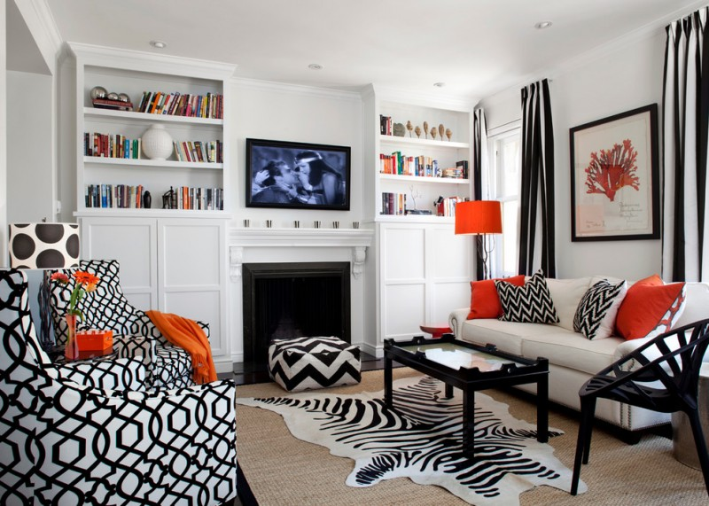 black and white living room furniture orange color accent cowhide rug white sofa glass table with black frame and legs built in cabinets
