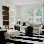 Black And White Living Room Furniture Stripe Black And White Rug Black Table White Sofa Armchair And Stool Black Side Tables Windows