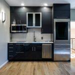 Black Cabinet Flat Panel Cabinet Stainless Steel Appliances Granite Countertop Undermount Sink Wooden Floor