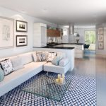 Black White Area Rug Glass Coffee Table White Walls Kitchen Cabinets Art Wall Decor White Corner Sofa Decorative Pillows
