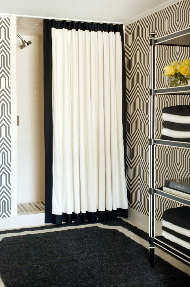 black white area rug shower curtain towels big rack black and white patterned walls shower space and floor tile shower head