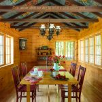 Cathedral Ceiling Lighting Lightwood Flooring Painted Ceiling Wood Beams Traditional Chandelier Wooden Walls Dining Table And Chairs