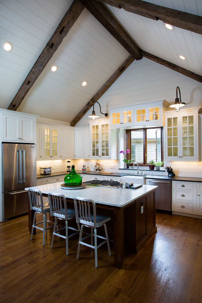 cathedral ceiling lighting wood beams recessed lighting wall pendants kitchen cabinets and island glass doors cabinets window