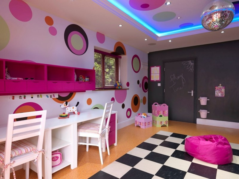cute bean black and white rug pink bean disco light pink wall mounted storage white desk with storage white chairs blackboard walls