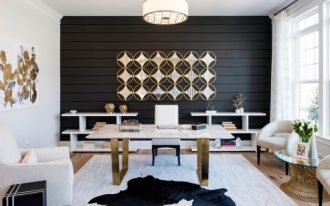dark wall freestading desk open shelves rug area wooden floor white armchair wall decoration glass rounded table white curtain white window pendant light