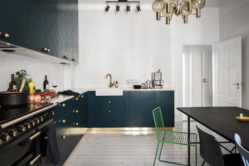 flat-panel cabinet dark cabinet patterned cabinet dining table granite countertop black appliances patterned backsplash pendant lights