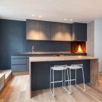 Flat Panel Cabinet Dark Cabinet Black Countertop Wood Countertop Bar Stools Fireplace Wooden Floor Undermount Sink