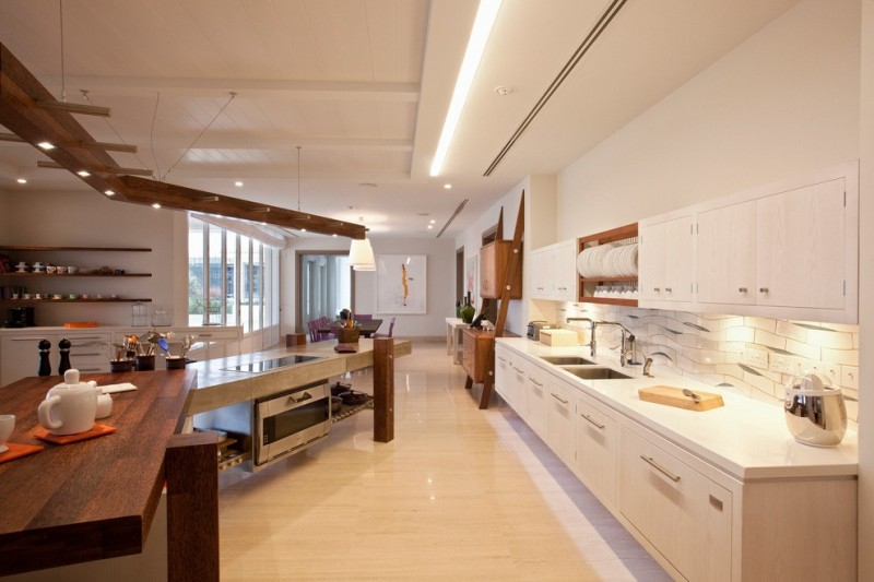 floating kitchen cabinets recessed lighting undermount sinks upper cabinets plate shelves white backsplash wooden kitchen island