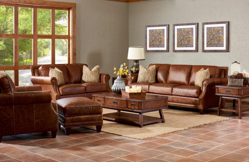 freestanding desk tan leather sofa leather ottoman slate floor rug area gray wall brown trim glass window wall decoration