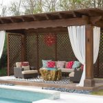 Gazebo Lighting Red Chandelier Wood Beams White Curtains Pool Area Rug Outdoor Sofa And Armchairs Colorful Pillows