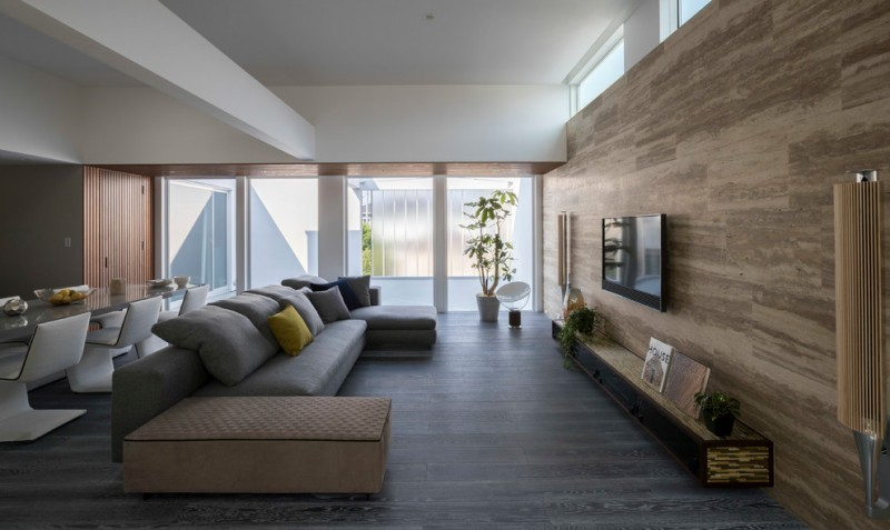 gray and brown living room brown accent walls grey sectional brown wooden ceiling white concrete ceiling gray floor glass windows