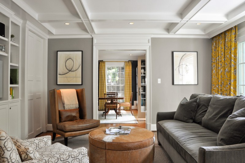 gray and brown living room brown leathered chair and ottoman grey couch pillows yellow curtains white cabinet and ceiling