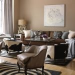 Gray And Brown Living Room Brown Sofa Grey Armchairs Side Tables Area Rug Brown Wall Unique Table Lamps Curtain White Artwork