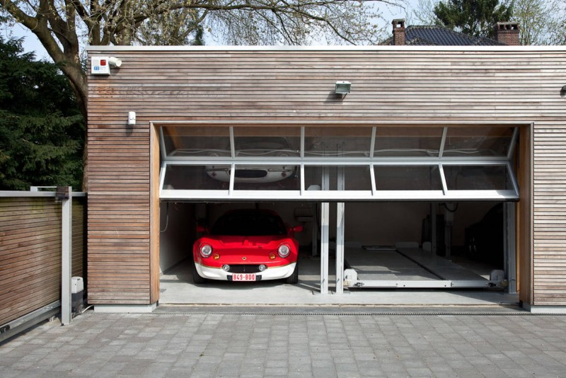 horizontal lined garage wooden garage track lights glass windows driveway
