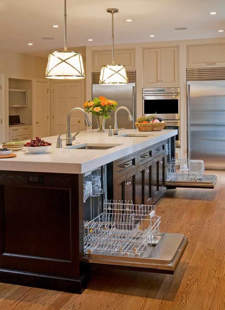 kitchen islands with sinks and dishwashers elegant pendant lights wood flooring recessed lighting white countertop wood island