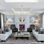 Mirror Tables For Living Room Crystal Chandelier Grey Curtains White Sofas Black Armchairs Grey Rug Fireplace Round Mirror Pillows