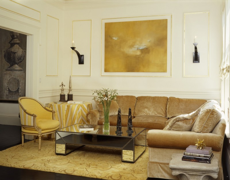 mirror tables for living room gold trims brown velvet corner sofa yellow patterned rug yellow armchair gold artwork