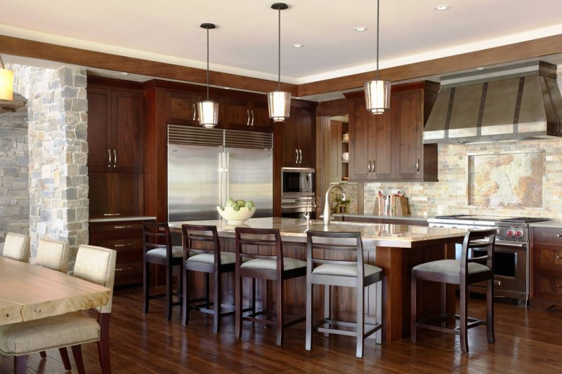 multicolored backsplash slate backsplash slate wall dark wood floor dark wood cabinet island bar stool granite countertop pendant lights eat in space undermount sink hood
