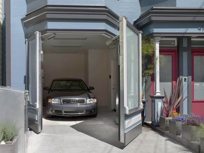 one car garage concrete door twist garage blue siding driveway