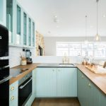 Pastel Kitchen Black Gloss Appliances Blue Cabinets Wood Countertops Glass Upper Cabinet Doors Pendant Lights Gold Faucet And Knobs