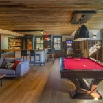 Pool Table Grey Sofa Freestanding Coffee Table Wooden Floor Wooden Ceiling Bar Kitchen Ceiling Lights Pendant Lights