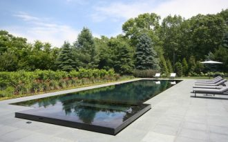 rectangular pool rectangular spa black tiled pool bluestone paver pool gray pool bench flowers
