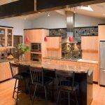 Slate Mosaic Backsplash Light Wood Cabinet Light Wood Floor Granite Countertop Bar Stools Pendant Lights Stainless Steel Hood Stainless Steel Appliances