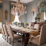 Victorian Dining Table Beige Patterned Dining Chairs Crystal Chandelier Table Cloth Area Rug Windows With Curtains And Valances Mirror