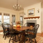 Victorian Dining Table Chandeluer Mediterranean Area Rug Glass Windows And Doors Black Chairs Fireplace Wall Sconces Artwork