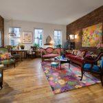Vintage Settee Floral Rug Colorful Vintage Seetees Small Coffee Table Windows Artwork Brown Brick Walls Armchair Floor Lamps