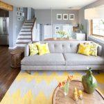 Yellow And Grey Decoration Area Rug Grey Sofa Coffee Table Yellow Pillows Staircase Windows Grey Walls Floor Lamp Wood Flooring