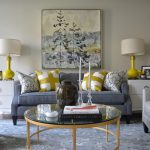 Yellow And Grey Decoration Painting Table Lamp Grey Sofa Decorative Pillows Armchairs Big Round Glass Table Area Rug