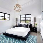 70s Bedroom Pendant Lamp White Sloped Ceiling Black Framed Windows Blue Herringbone Rug Black Bed Nightstands