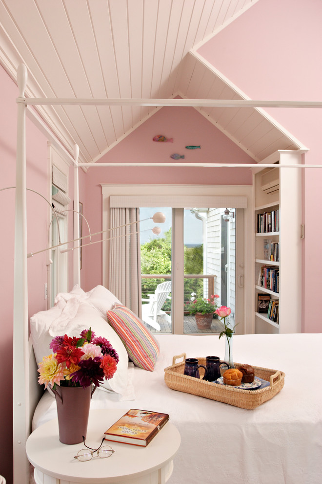 70s bedroom pink walls pink vaulted ceiling white bed white side table rattan tray purple flower pot white shelves glass doors