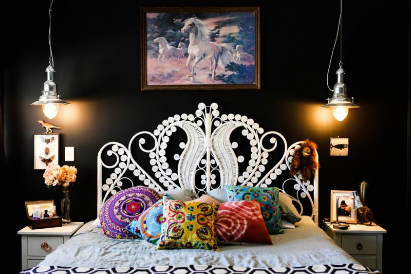 70's furniture white headboard artwork black wall white bed colorful pillows nightstands industrial pendant lamps