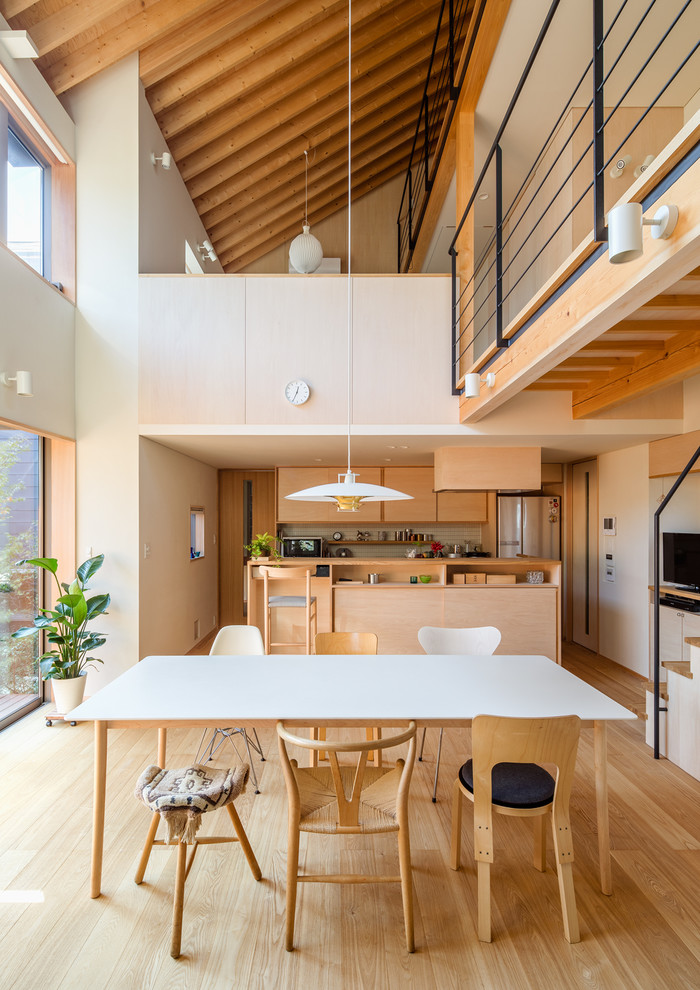 asian dining table minimalist wooden dining table multidesigned chairs wooden floor pendant lamp railing glass windows beams
